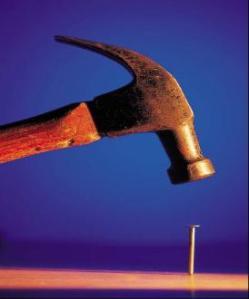 Hammer_hitting_Nail-274x330