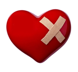 close up of a heart shape with bandage on white background